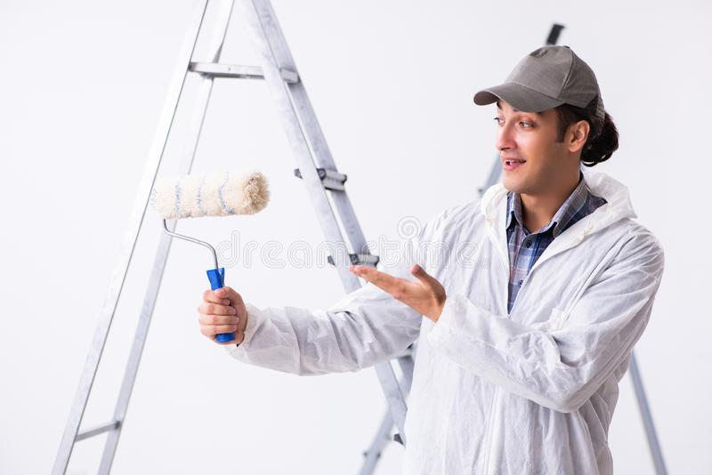 Painter working at construction site. Painter working at the construction site stock photos