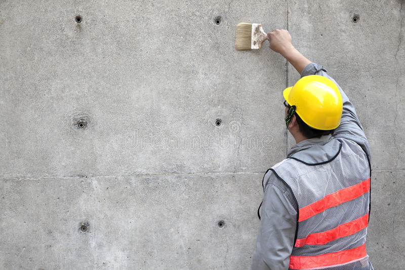 Painter working on the old wall royalty free stock photography