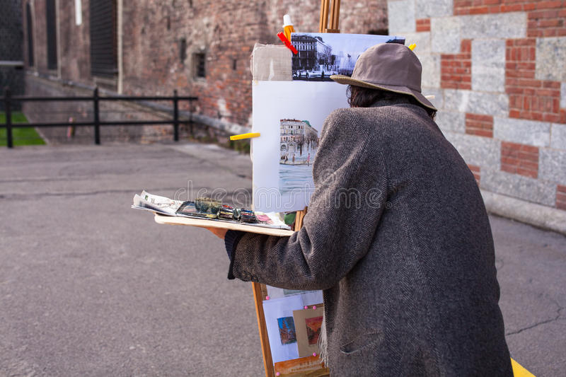 Painter working in the street stock images