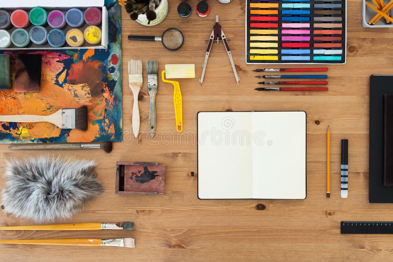 Painter workplace top view. Wooden table of an artist with art tools for drawing. stock photography