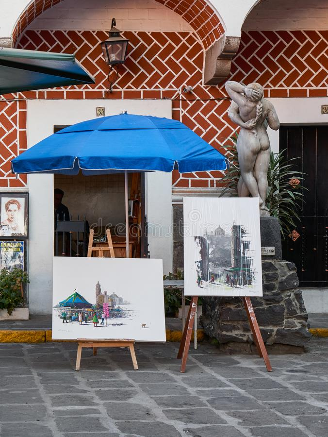 Painter workshop in artist quarter. Workshop of Mexican painter with his exhibition paintings in Mexican Artist Quarter of Puebla, Barrio Del Artista, Calle 8 royalty free stock photography