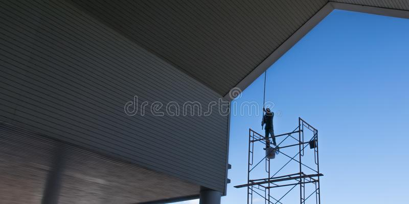 Painters are painting the building. royalty free stock image