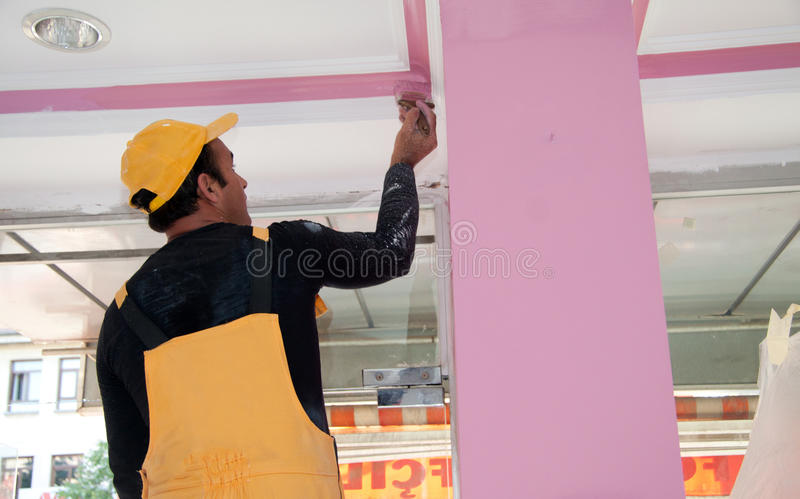 Painters painting details, construction workers royalty free stock photos