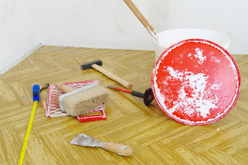 Painting accessories. On the floor royalty free stock photo