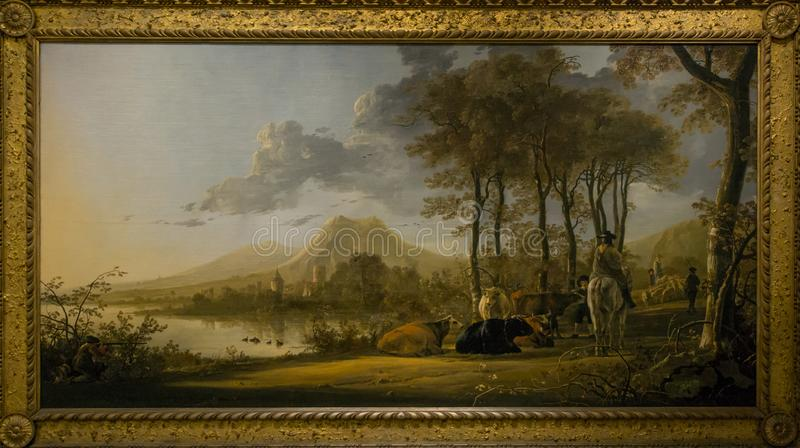 A painting by Aelbert Cuyp in the National Gallery in London. A painting by Aelbert Cuyp - River Landscape with Horseman and Peasants. Beautiful framed painting stock image