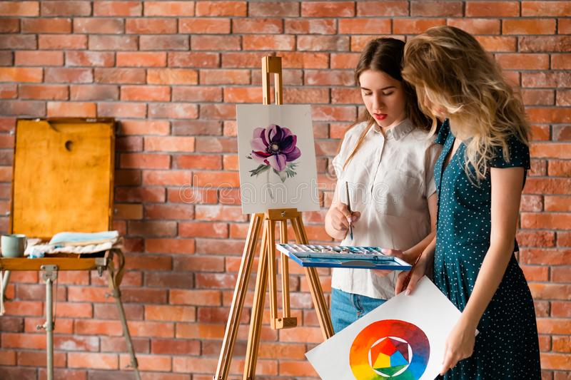 Paint art class watercolor teacher student communication. Painting art classes. drawings creation. learning to work with watercolor. teacher and student stock photos