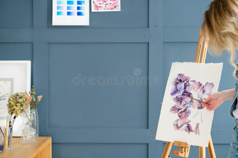 Painting art class teacher watercolor drawing. Painting art classes. teacher explaining. inspiration imagination self expression concept stock photography