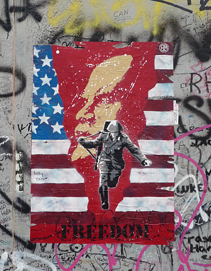 Painting on Berlin wall at East Side Gallery royalty free stock photos