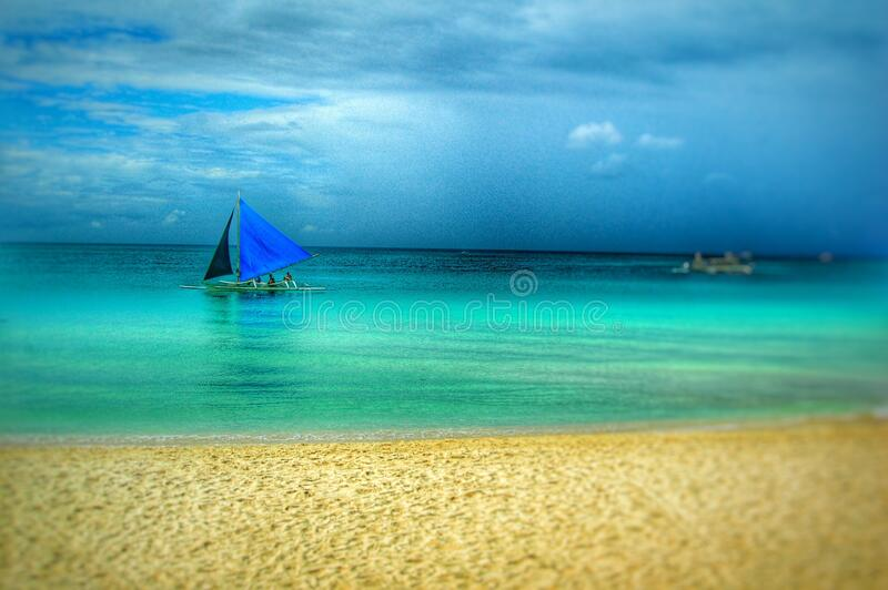 Painting of Blue Boat on Beach stock image