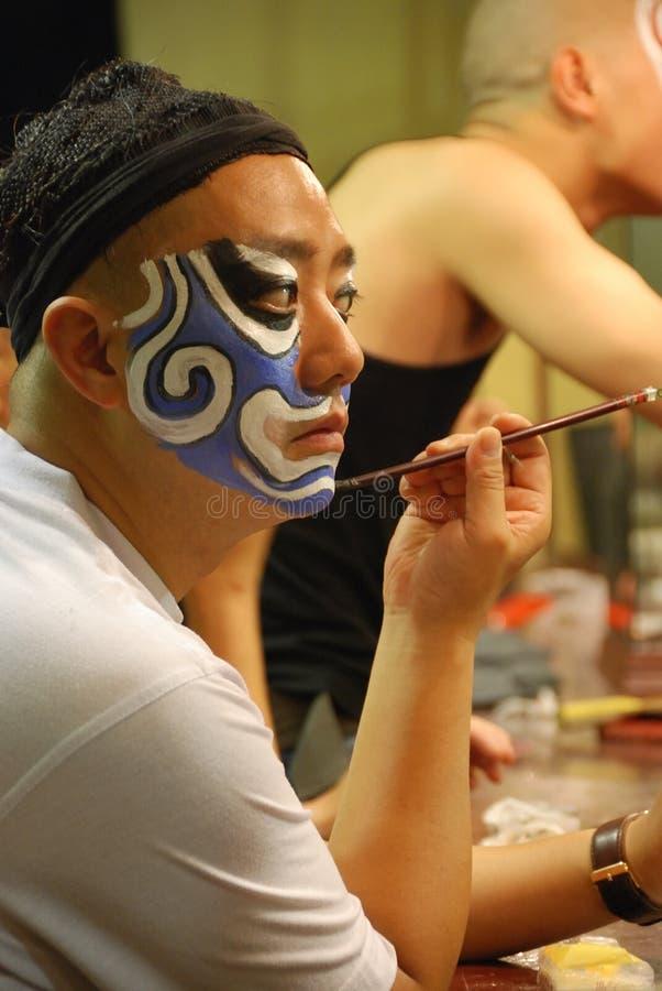 Painting blue masks stock photo