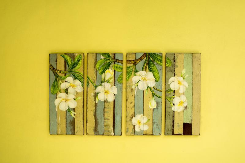 Painting Board of Flower on the Wall. Painting Board of Flower on yellow Wall royalty free stock photo