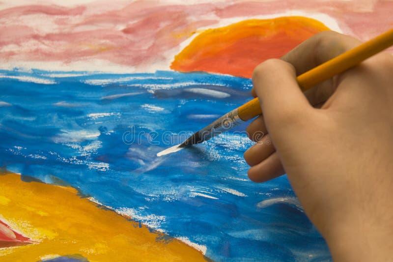 Painting with brush stock photo