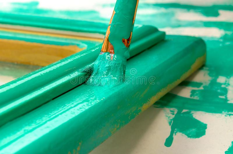 Painting carried out by a brush. Painting of elements of a decor stock photo
