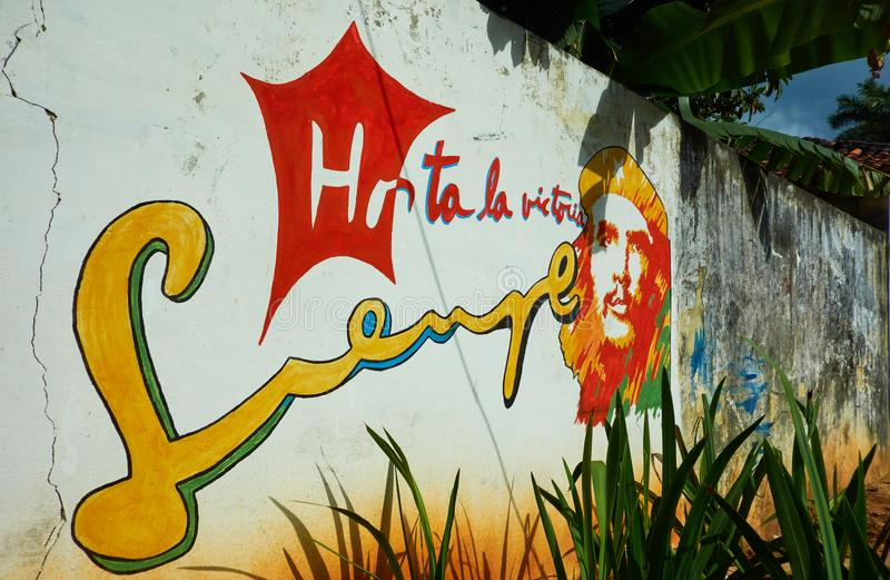 Painting of Cuban revolutionary commander Che Guevara and slogan Hasta La Victoria Siempre on the wall in Vinales royalty free stock images