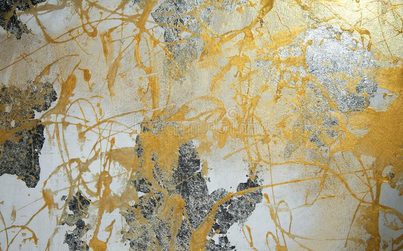 Painting on drywall, yellow paint, silver patina, composition, texture royalty free stock image