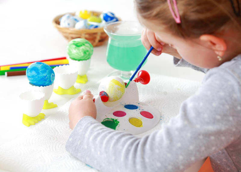 Painting Easter eggs royalty free stock photos