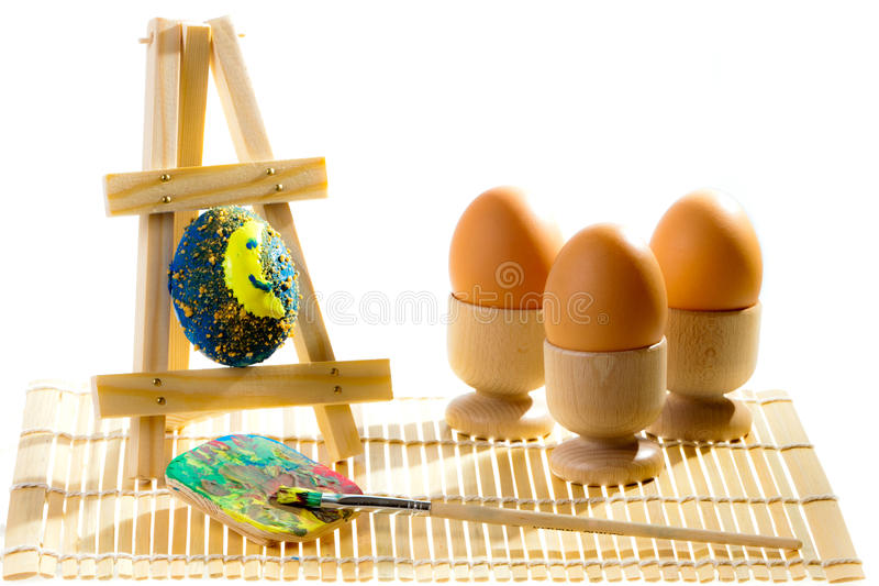 Painting easter eggs in workshop royalty free stock photography
