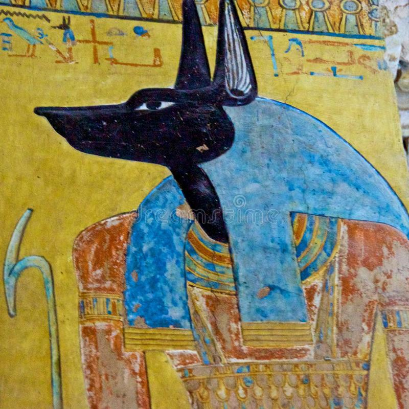 Painting of Egyptian god of Anubis in the Valley of Kings in Luxor, Egypt. Painting of Egyptian god of Anubis in the Valley of Kings in Egypt stock image