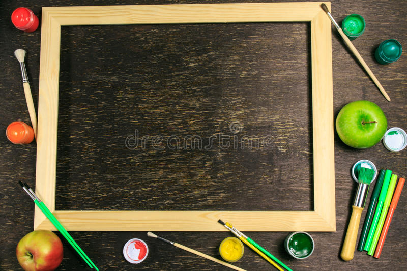 Painting equipments with apples royalty free stock photography
