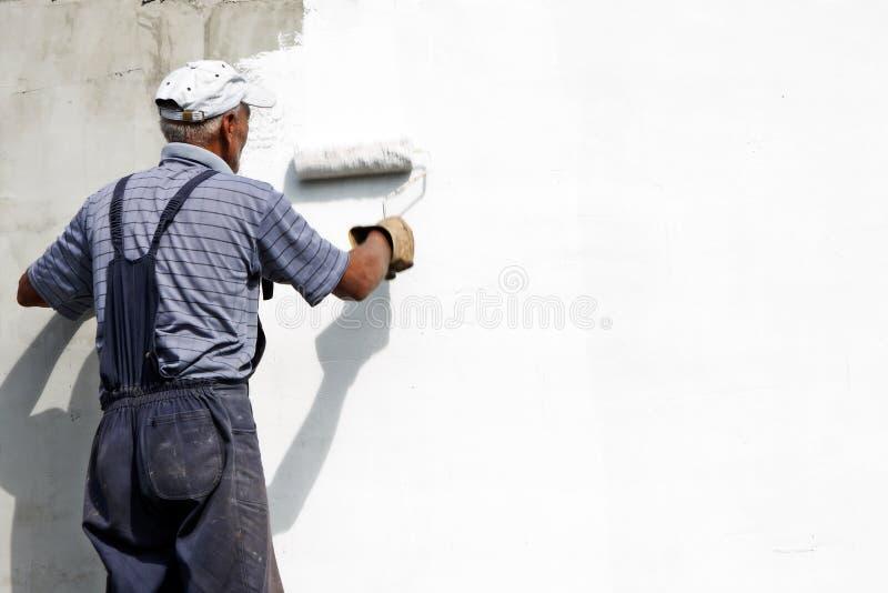 Painting the facade stock photos