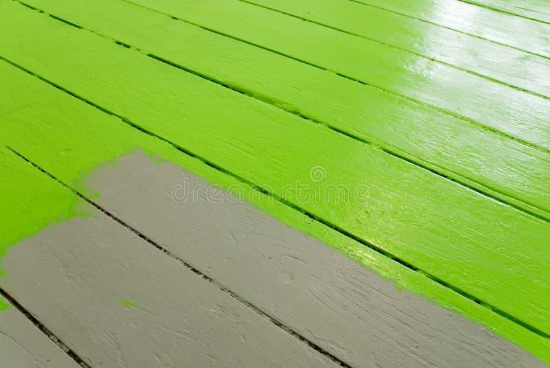 Painting the floor stock photos