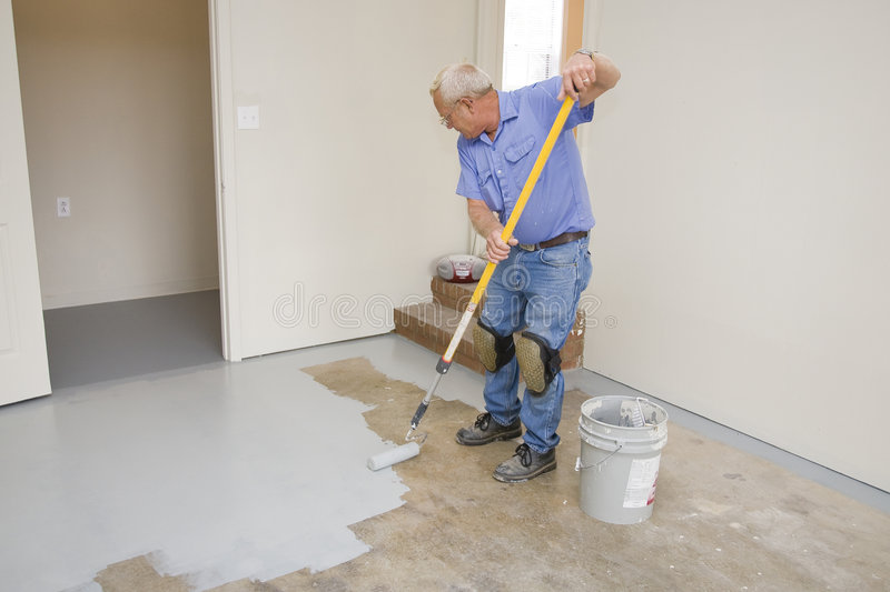 Painting garage floor royalty free stock image