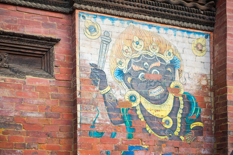 Painting of god on the wall at Patan Durbar Square. Nepal royalty free stock images