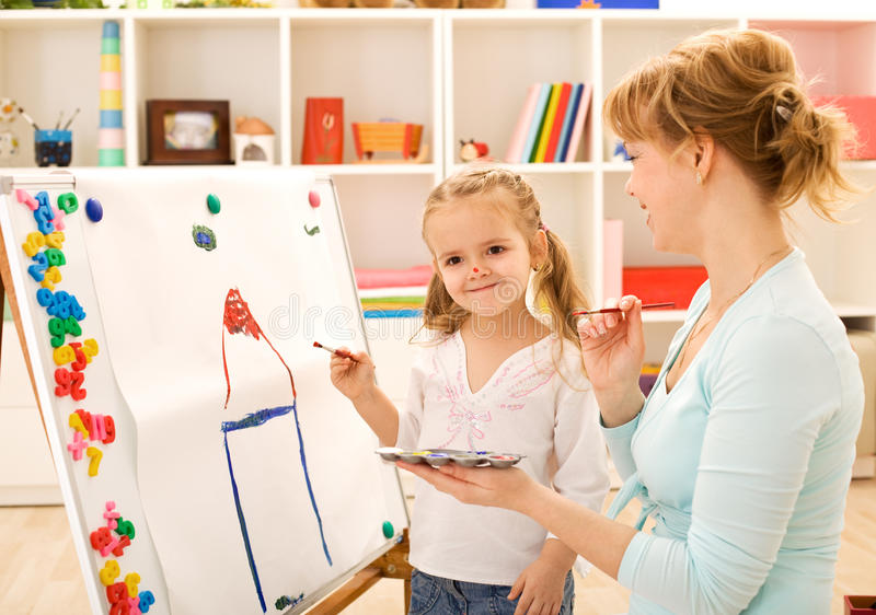 Painting And Having Fun With Mom Royalty Free Stock Photos