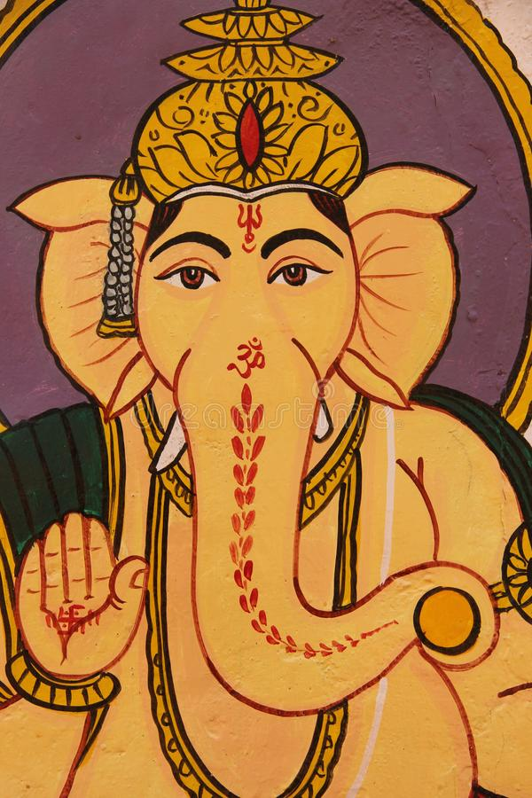 A painting of the hindu god Ganesha. Decorates a wall on one of the building in the city of Jaisalmer, India royalty free stock image