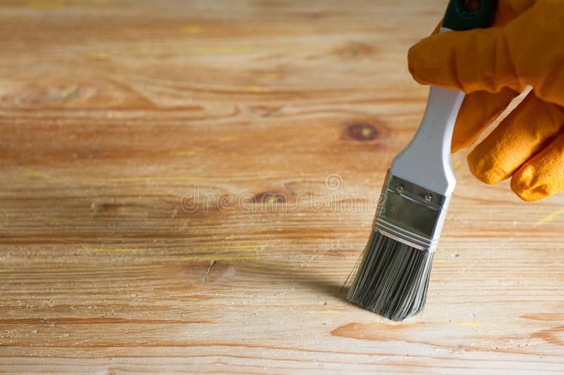 Painting and home renovation abstract background on wooden board. Closeup stock photos