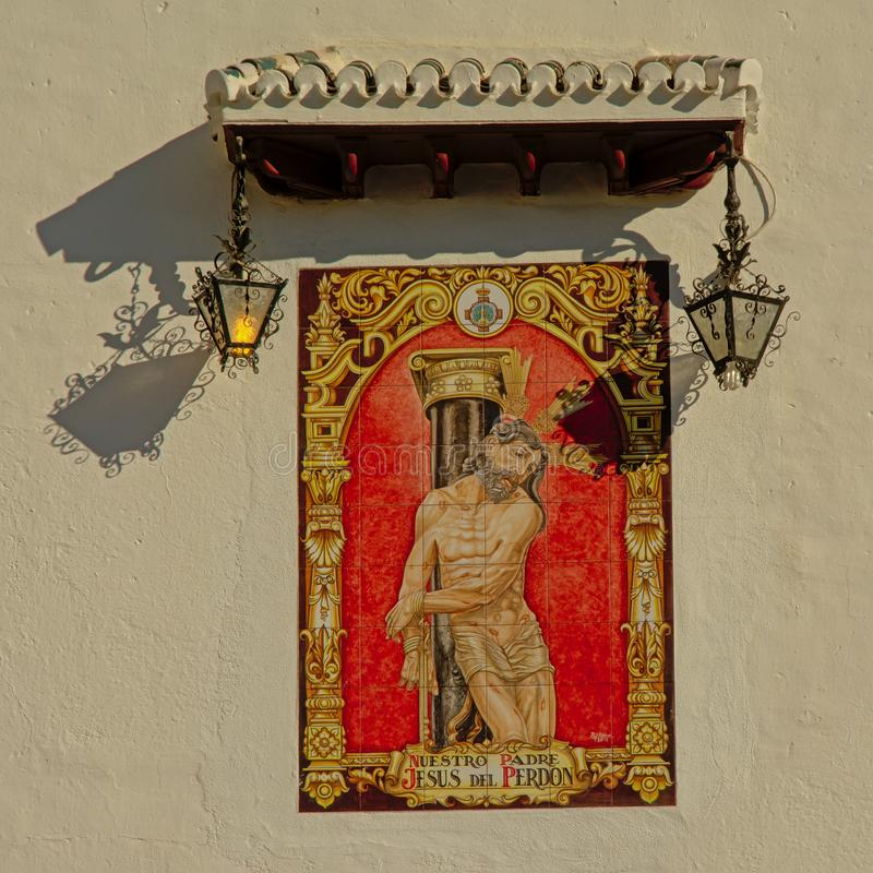Painting of Jesus with wounds , bound to a pillar. Found on the side of a church in Albayzin neighborhood in Granada, Spain stock photography