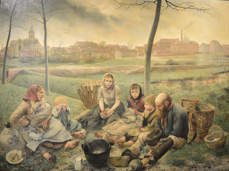 The chalk sellers - At Noon, painting by Léon Frédéric. The painting made in 1882 is depicting a poor family having lunch all together on the field. L stock image