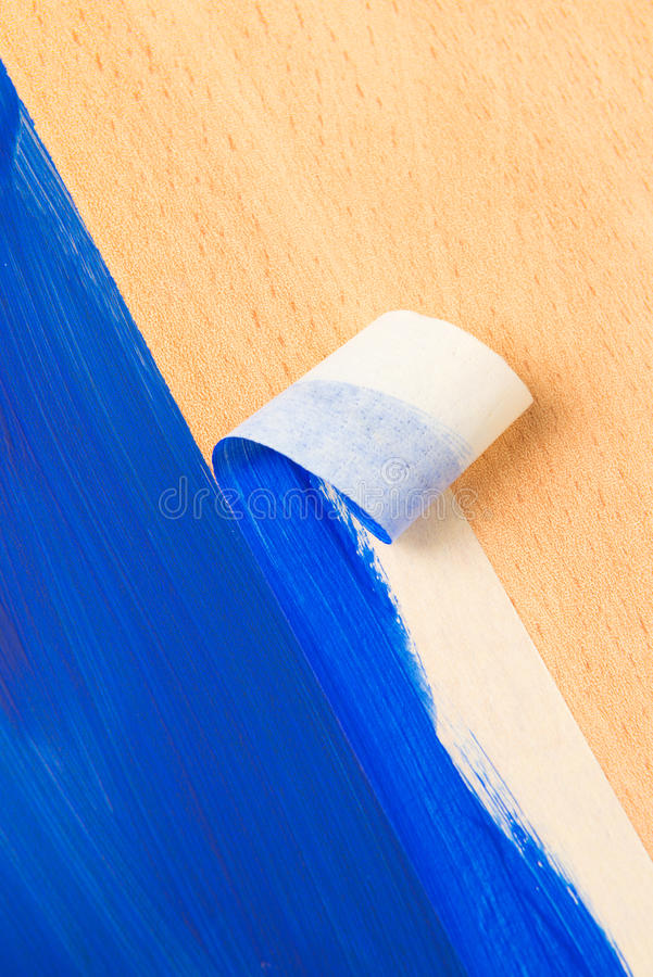 Painting with masking tape. Also known as sticky tapy stock images