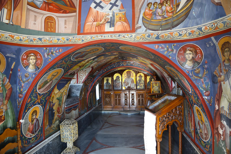 Painting at Orthodox Greek church. Typical little white orthodox Greek church in the harbor of Aegina stock photography