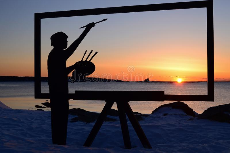 Painting the perfect sunrise on Great Island, New Hampshire stock images