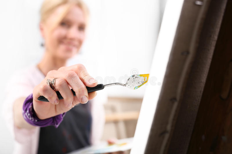 Painting a picture spatula royalty free stock images