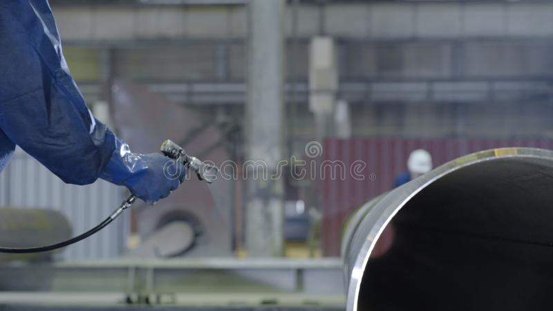 Painting pipes in industry closeup. Production of pipes in the industry.  royalty free stock image