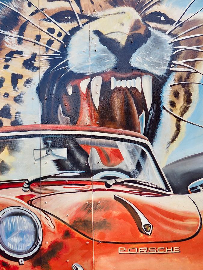 Painting of a Porsche car with a tiger royalty free stock photo