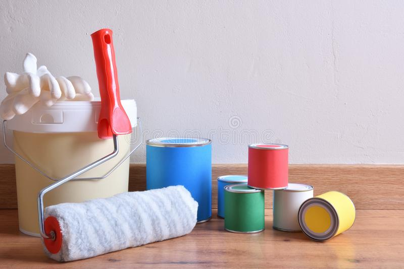 Painting pots for home on parquet in a room royalty free stock photo