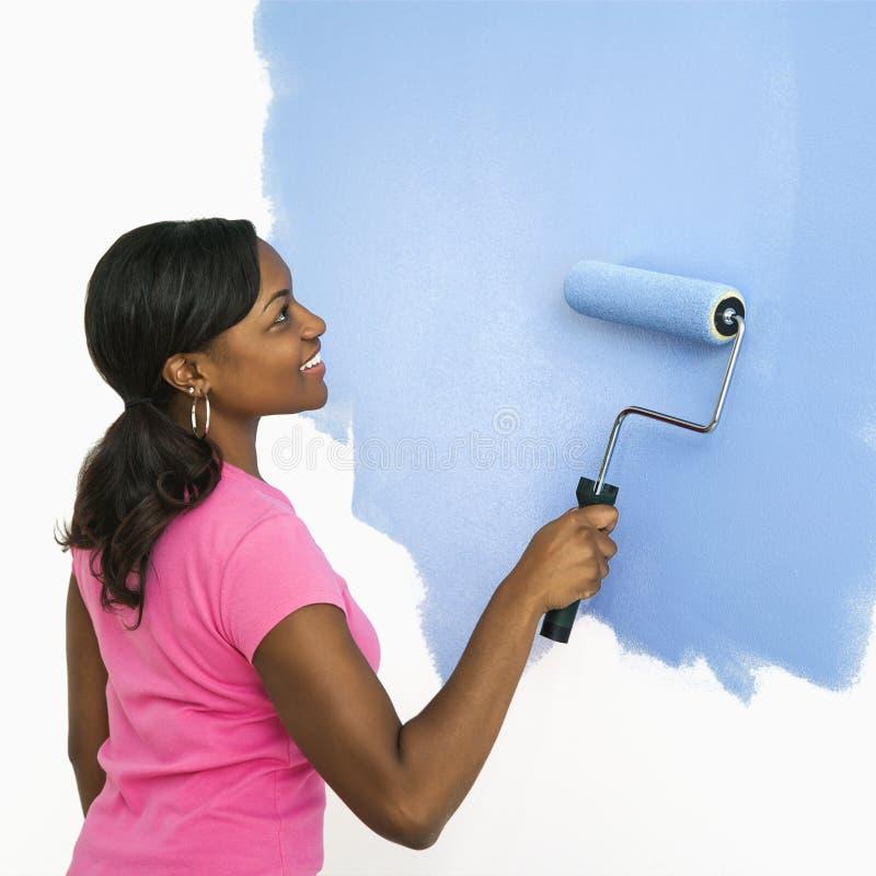 painting pretty wall woman στοκ φωτογραφίες με δικαίωμα ελεύθερης χρήσης