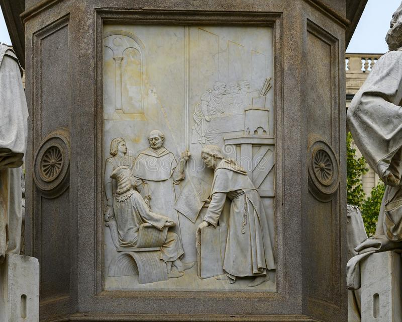 Painting relief front of the Monument to Leonardo Da Vinci in Piazza della Scala Square, Milan, Italy. Pictured is a relief representing Leonardo`s mastery of stock photo