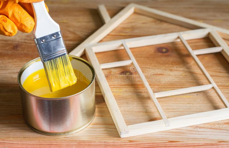 Painting and renovation home construction on wooden background. Art royalty free stock photos