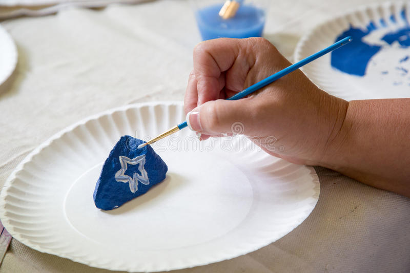 Painting a rock by hand royalty free stock images