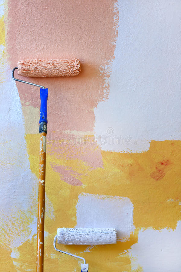Painting roller on the wall stock images