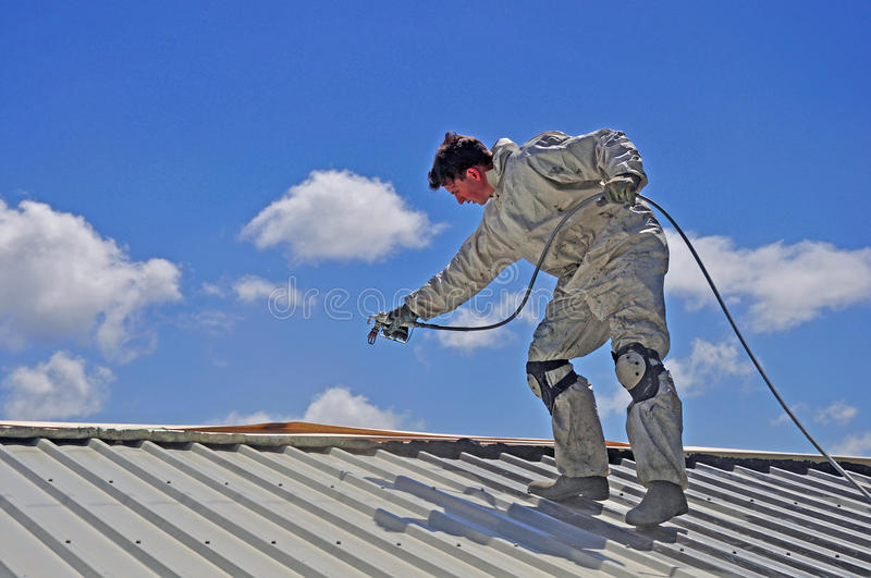 Painting the roof stock images