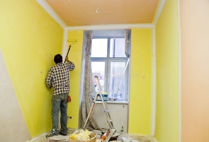 Painting room in yellow stock image