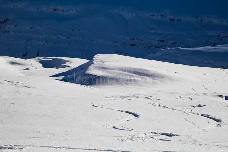 Painting skiers in powder snow. Free ski terrain, Alps in Flaine area, Grand Massif, France stock images