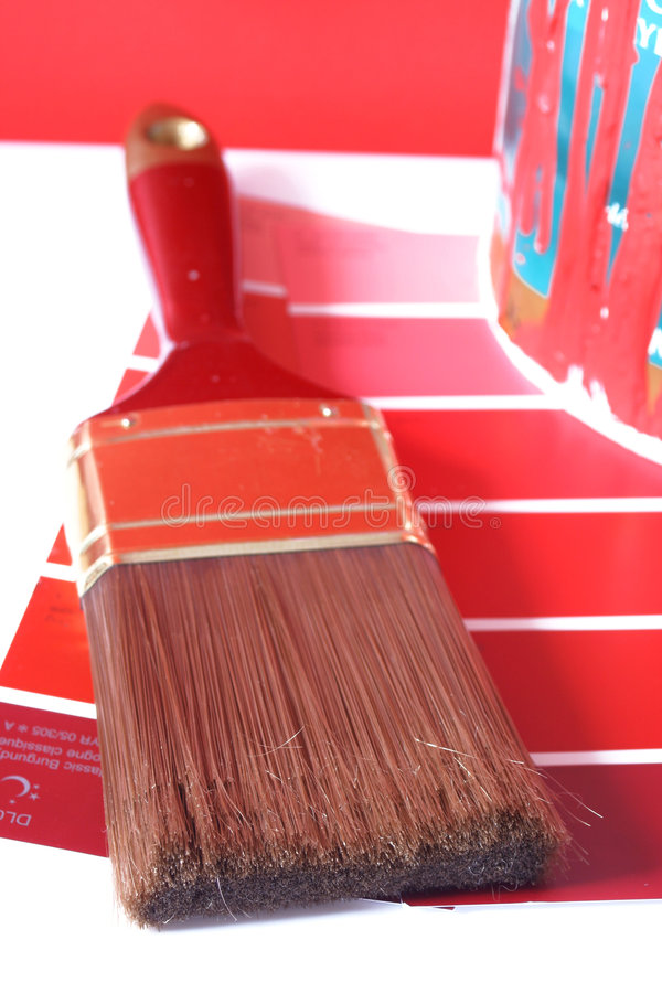 Painting supplies. Paint swatches, and paintbrush and red paint can for home decorating royalty free stock photos