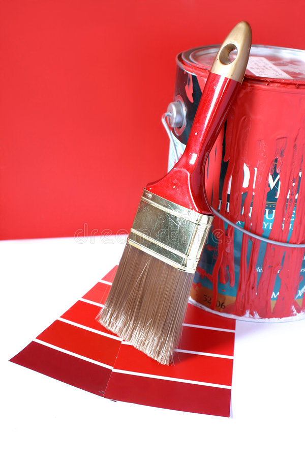 Painting supplies. Paint swatches, and paintbrush and red paint can for home decorating stock images