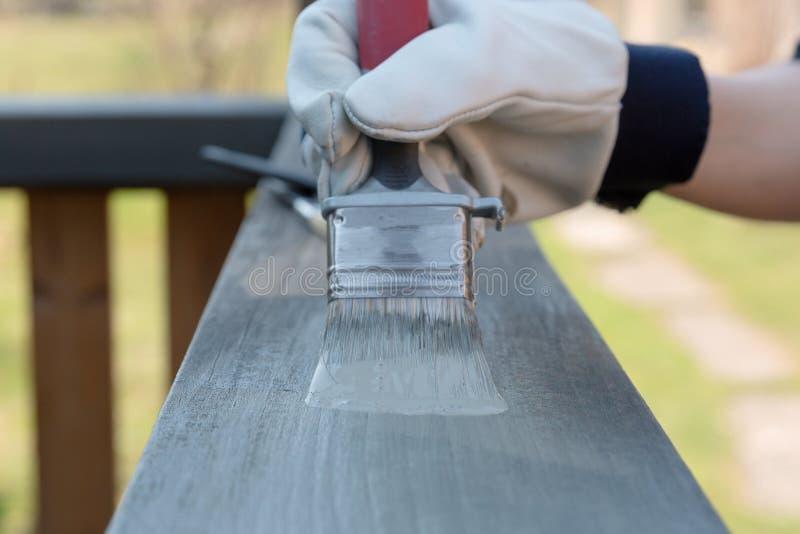 Painting terrace railings, home improvement, garden works. stock photo